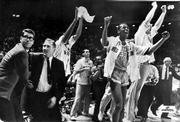 "Texas Western College head basketball coach Don Haskins, second from left, and players celebrate after winning the 1966 NCAA basketball championship, in this March 19, 1966, photo in College Park, Md. Texas Western defeated Kentucky 72-65. The journey to the game is chronicled in ""Glory Road."""