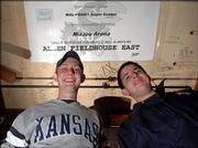 Chris Kaufman, 2005 KU graduate, left, and Rich Littrell, KU senior, were part of a group of students who got into a scuffle with the MU police chief over a banner they displayed during last year's KU/MU basketball game in Columbia. The banner now hangs on the ceiling of The Wheel, 507 W. 14th St.