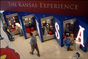 Workers prepare the Kansas Experience exhibit in the new Booth Family Hall of Athletics, which opens Saturday at 12:30 p.m. The two-story, $5 million, 26,000-square-foot space is now part of Allen Fieldhouse at Kansas University.