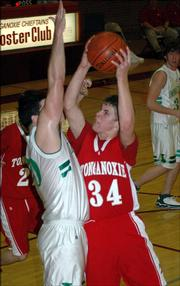 Tonganoxie junior Zeb Kissinger puts up a shot against Immaculata's Nick Kaufman.