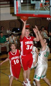 Tonganoxie junior Zeb Kissinger goes up for two points against Immaculata's Nick Kaufman
