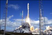 An Atlas V rocket that will carry the New Horizons spacecraft on a mission to the planet Pluto lifts off from a launch pad at the Cape Canaveral Air Force Station. Thursday's liftoff was just the start of a lengthy journey: The spacecraft is estimated to reach Pluto sometime in 2015.