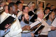 East Hill Singers perform during a recent concert in Topeka. The choir group is a mixture of Lansing Prison inmates and civilian vocalists.