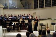 Elvera Voth leads the East Hill Singers during a recent concert at Village Presbyterian Church in Prairie Village.