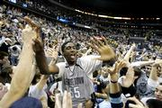 Georgetown's Roy Hibbert is swarmed by fans after the Hoyas defeated top-ranked Duke. Georgetown won, 87-84, Saturday in Washington.