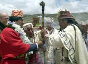 Bolivian President-elect Evo Morales, left, receives an indigenous symbol of leadership from Aymara priest Valentin Mejillones on Saturday at the archaeological site of Tiawanacu, Bolivia, where Morales attended a ceremony to ask Andean gods for help and guidance on the eve of his inauguration as Bolivia's new president.