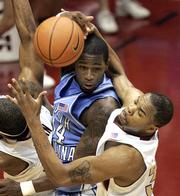 North Carolina's David Noel, left, and Florida State's Alexander Johnson contest a second-half rebound. UNC held off the Seminoles, 81-80, on Sunday in Tallahassee, Fla.
