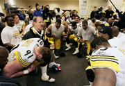Pittsburgh coach Bill Cowher leads the team in prayer after the Steelers beat Denver, 34-17, in the AFC championship game. Pittsburgh won Sunday in Denver to clinch a trip to the Feb. 5 Super Bowl.
