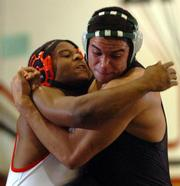 Lawrence High's C.J. Williams, left, tangles with Free State High's Andy Neighbors. Williams won the 215-pound match Tuesday at LHS.