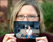 Julie Cowdin, 36, carries this photo, which shows her without hair, as a reminder of tougher times when she was undergoing chemotherapy for breast cancer. Because she tested positive for the cancer gene BRCA 2, she underwent a double mastectomy and a hysterectomy on her 35th birthday.