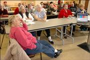 Seniors listen to a description of the new Medicare Prescription Drug Coverage options at recent informational meeting at the Douglas County Senior Services. The meeting offered by the Senior Citizen Health Consultation of Kansas to help explain the plan and what options are available for those elgible.