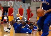 Kansas freshman Julian Wright stretches during pregame warmups at the Hilton Colliseum in Ames, Iowa.