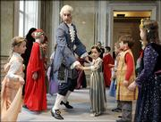 Ballet dancer Markus Zarl, dressed up as Mozart, instructs children how to dance a minuet during a special event at the Karajan Centrum in Vienna. Friday's event was part of worldwide celebrations Friday marking Mozart's 250th birthday.