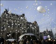 Hungarians release 600 balloons in front of the Parliament building Friday on the U.N.'s first International Holocaust Remembrance Day in Budapest, Hungary. Some balloons were carrying the names of those who lost their lives in the Holocaust.