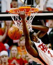 Texas Tech's Martin Zeno dunks against Oklahoma State. The Red Raiders beat the Cowboys, 92-90 in overtime, Saturday in Lubbock, Texas.