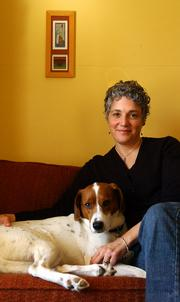 Mary Wharff, photographed with her dog Zoe, won this year's Langston Hughes Creative Writing Award for fiction.