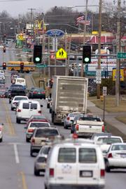 Traffic flows past the corner of 23rd Street and Ousdahl Road.