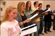 Kansas University students, from left, Heather Cwizk, Overland Park freshman; Andrea Patten, Minneapolis, Minn., junior; Julie Mann, Overland Park junior; Brian Altman, Overland Park junior; Ross Fishman, Minneapolis, Minn., sophomore; and Matt Rissien, Overland Park freshman, sing during practice for the choral group Sharim Netzim, which focuses on singing Jewish music. The 3-year-old choir performs two to four times a semester.