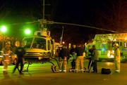 Emergency personnel help to load one of two shooting victims into a helicopter ambulance early Sunday morning near the intersection of 11th and Massachusettes streets in downtown Lawrence. Police were investigating the shootings this morning, which occurred outside the Granada in the 1000 block of Massachusetts.