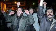 Iranians chant slogans Saturday during a demonstration to support Iran's nuclear program and to protest against the publication of cartoons mocking the Prophet Muhammad in European newspapers in Tehran, Iran.