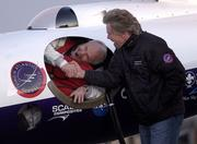 Pilot Steve Fossett shakes hands with Sir Richard Branson as he prepares to take off in the GlobalFlyer on Feb. 28, 2005, at the Salina Municipal Airport in Salina. Fossett plans to use the GlobalFlyer in an attempt to break the record for longest flight.