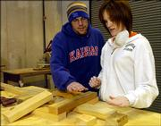Ken Simmons and April Young, both Kansas University architecture students, look over some angles for a community center their architecture class is building to help residents of the Seventh Ward in New Orleans.