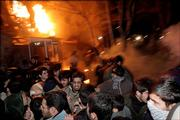 Protesters flee after police spray tear gas in front of the Danish Embassy in Tehran, Iran. Police had encircled the embassy building on Monday but were unable to hold back the mob of 400 demonstrators as they pelted the walled brick villa housing the Danish mission with stones and Molotov cocktails. The protests were among several in Islamic nations Monday sparked by the publication of cartoons deemed insulting to the religion.
