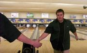 Free State's Mike Herschell accepts congratulations from a teammate after bowling a 205. Free State's boys and Lawrence High's girls won Tuesday at Royal Crest Lanes.