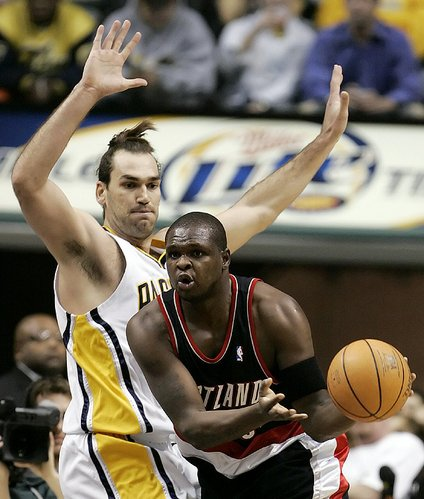 Indiana's Scot Pollard, left, defends Portland's Zach Randolph. Pollard had six points and 16 rebounds in the Pacers' 101-69 victory Wednesday night in Indianapolis.