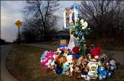 Stuffed animals and other toys adorn a roadside memorial for Bryce Olsen at the corner of East 25th Terrace and Harper Street. Bryce, 6, died last week at the intersection when he was struck by a minivan, but no criminal charges will be filed against the driver.