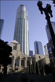 The U.S. Bank Tower, formerly known as the Library Tower, is shown Thursday behind the central Los Angeles Library. President Bush said Thursday the U.S-led global war on terror foiled purported terrorist plans to fly a commercial airplane into the Los Angeles skyscraper in 2002.