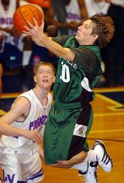 Free State's Nick Devin drives to the basket against Leavenworth Friday.