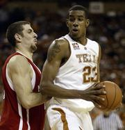 Texas forward LaMarcus Aldridge, right, looks to pass around Nebraska's Aleks Maric. The Longhorns routed the Huskers, 78-59, Saturday in Austin, Texas.