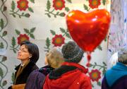 Gay Lynn Clock, of Baldwin, joins others browsing through the display of quilts Saturday afternoon during the ninth annual Pie Sale and Quilt Show at Plymouth Congregational Church, 925 Vt.