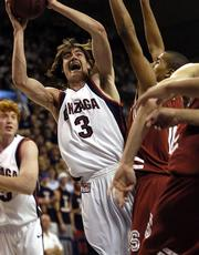Gonzaga's Adam Morrison (3) shoots past Stanford's Lawrence Hill. Morrison scored 34, helping the Bulldogs beat the Cardinal, 80-76, Saturday in Spokane, Wash.
