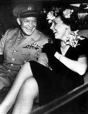 Alone together for the first time since Gen. Dwight D. Eisenhower arrived home from World War II, Eisenhower and his wife, Mamie, go to meet President Truman, in this June 18, 1945, file photo. A new book of letters explores the emotional lives between presidents and their wives.