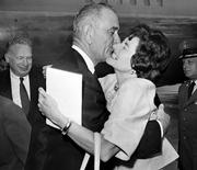 "Vice President Lyndon Johnson gets a welcoming kiss from Lady Bird Johnson at Andrews Air Force base in this Aug. 21, 1961, file photo. Presidents who were wild about their wives were not necessarily faithful to them. Lady Bird once shrugged off her husband's affairs as a ""speck on a wedding cake."""