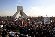 Tens of thousands of Iranians listen Saturday to the speech of Iranian President Mahmoud Ahmadinejad, unseen, in a ceremony marking the 27th anniversary of Iran's Islamic Revolution at the Azadi Square in Tehran, Iran.