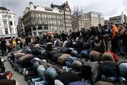 Muslim demonstrators kneel to pray Saturday during a demonstration at Dam Square in Amsterdam, the Netherlands. About 200 Muslims staged a demonstration against publication of cartoons portraying the Prophet Muhammad, ignoring pleas from mainstream Muslim leaders for restraint.