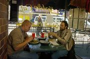 Scott Workman, left, and Steve Dahlberg enjoy a meal at the Aladdin Cafe, 1021 Mass.