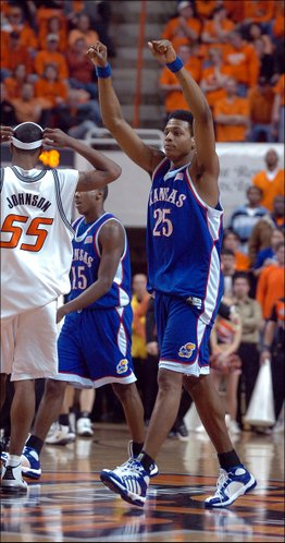 Walking off the court during a timeout Kansas guard Brandon Rush throws his fists in the air before the Cowboy fans as the Jayhawks begin to run away with the game, Monday night at Gallagher-Iba Arena.