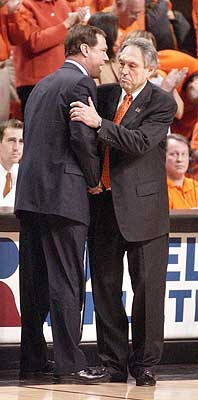 Kansas coach Bill Self, left, congratulates Oklahoma State's Eddie Sutton after the Jayhawks' 80-60 loss to OSU in Stillwater, Okla., on Feb. 9, 2004. The game marked Self's first trip to his alma mater as coach of the Jayhawks.
