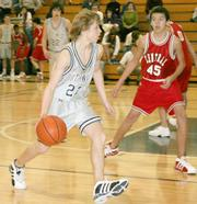 Southwest guard Nick Hassig dribbles past Central forward Bo Schneider during the first half. Southwest's eighth-grade team defeated Central 30-23 Feb. 6 at Southwest Junior High.