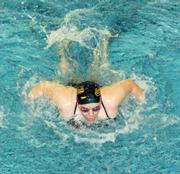 Aquahawk Julia Payton swims the 100 fly and places six in the race Saturday in the MAL West Championships.