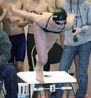 Aquahawk Stacey Rudman dives off the block to begin the 100 freestyle race Saturday in which she had the early lead.