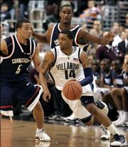 Connecticut's Marcus Williams (5) and Hilton Armstrong, right, guard Villanova's Allan Ray (14) in the second half Monday, Feb. 13, 2006, during their college basketball game in Philadelphia. Ray had five 3-pointers in the 22-4 run that gave Villanova the lead for good in its ninth straight victory as No. 4 Villanova upset No. 1 Connecticut, 69-64.
