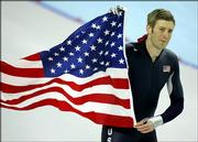 United States Joey Cheek, from Greensboro, N.C., holds an American national flag as he makes a victory lap during the Winter Olympics men's 500 meter speedskating sprint race at the Oval Lingotto in Turin, Italy, Monday, Feb. 13, 2006. Cheek won the gold medal in event.