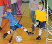 Curtis Wesley takes a shot against Zachary Malsbury Saturday at Holcom Rec Center.