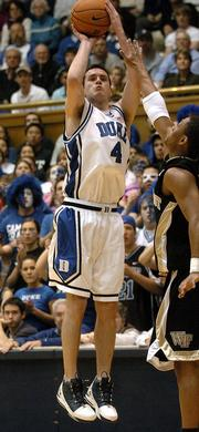 Duke's J.J. Redick hits a three-pointer against Wake Forest. Redick set the NCAA record for career three-pointers in the Blue Devils' 93-70 victory Tuesday night in Durham, N.C.