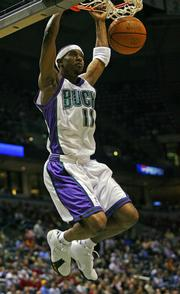 Milwaukee's T.J. Ford dunks against Seattle. The Bucks beat the SuperSonics, 106-91, Tuesday in Milwaukee.